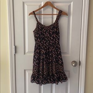 Cute black sundress with floral detailing